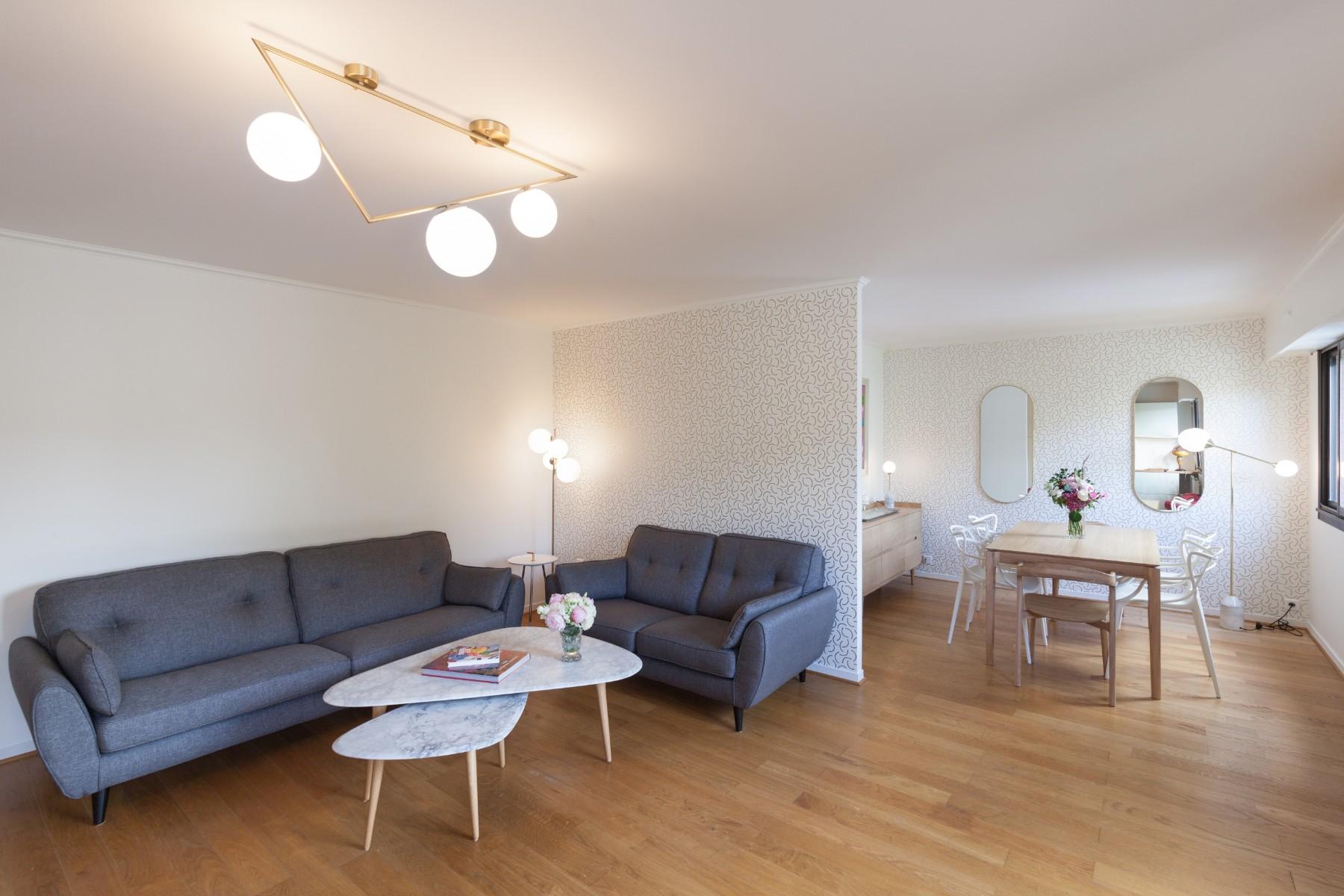 Rénovation d'un appartement à Paris aménagement de la pièce principale avec un architecte Archibien