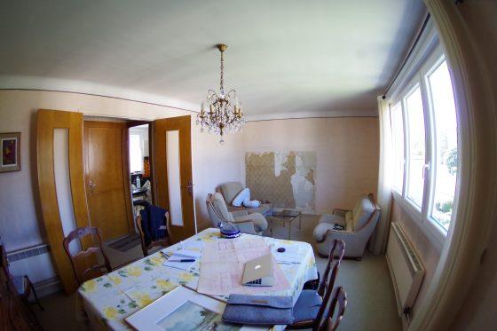 Photographie du salon / salle à manger avant l'arrivée du couple