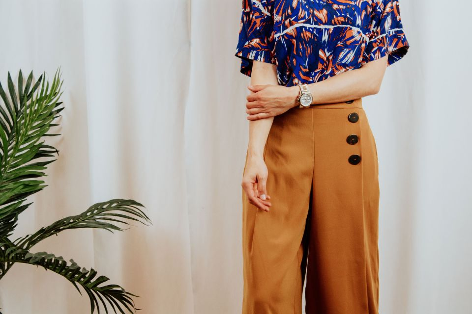 woman wearing blouse women's culottes pants