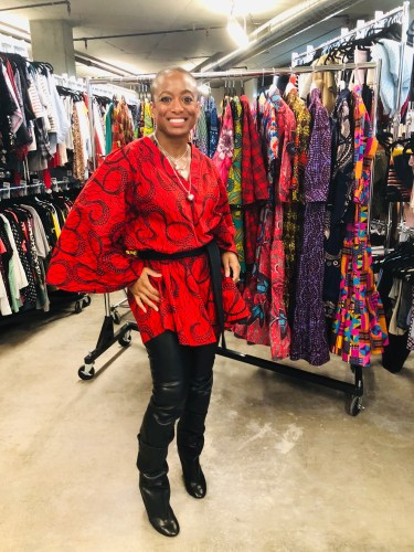 Erika in The Poet Printed Shift (dress) in Red Multi, paired with black faux fur leggings and boots. Style bold prints for fall with Armoire!
