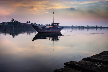 Boat on Thu Bồn River in Hội An at Sunrise