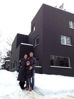 Wei, Gregor, and Rose in front of the Passive House.