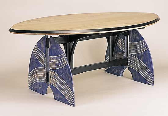 """""""Feeling a kinship with the innocence, honesty, and directness of primitive art, Erik Wolken constructed this table base, whose carved and painted legs were inspired by African tribal warrior shields."""" -- Michael Monroe (shown: Table for my Tribe by Erik Wolken)"""