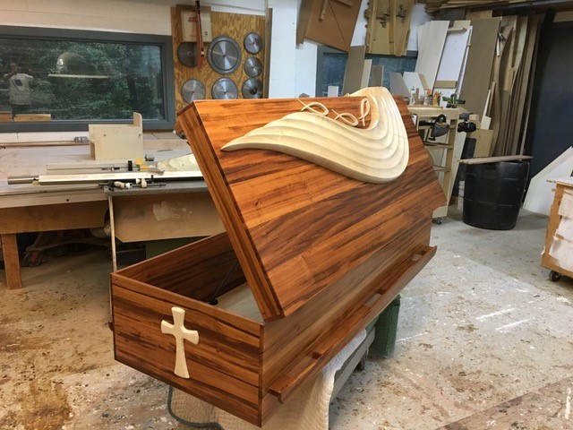 finished custom casket by furniture artist Blasie Gaston