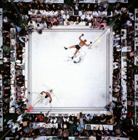 Aerial of Muhammad Ali victorious after his round three knockout of Cleveland Williams during the World Heavyweight Title fight at the Astrodome. Houston, Texas 11/14/1966 (Image # 1002 )