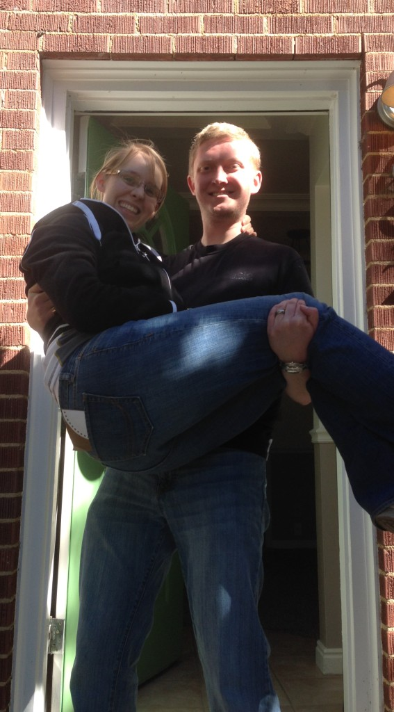 Kyle carrying me into our first house.