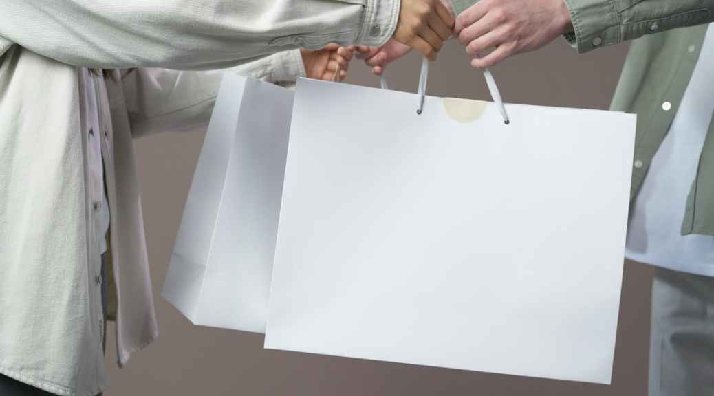 person in gray long sleeve shirt holding white paper
