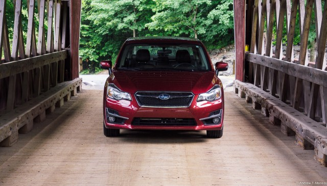 Front view of a red 2015 Subaru Impreza 2.0i Limited Sedan
