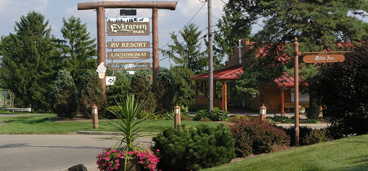 Evergreen Park RV Resort, picture of the entrance of evergreen park rv resort with the sign and registration building