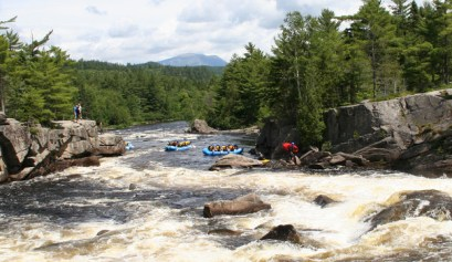 the camping checklist you may not think of, picture of white water rafting