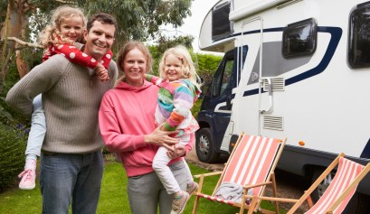 Portrait Of Family Enjoying RV Camping Holiday In Camper Van
