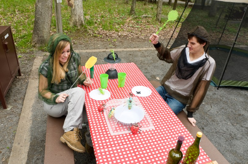 """Couple trying to have a camping picnic, but the bugs are too bad - Deep Creek Lakealypse 2010"""