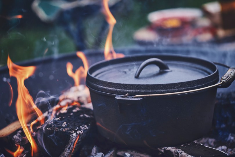 Campfire recipes in a cast-iron pot over the campfire