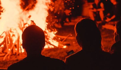 Four Scary Campfire Stories around the fire with a bunch of friends
