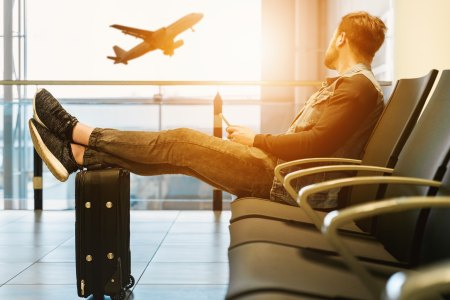 Man sitting in airport waiting for his flight