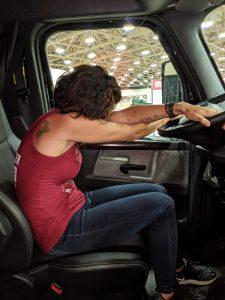 Hope Zvara demonstrating a pelvic tilt sitting inside a truck