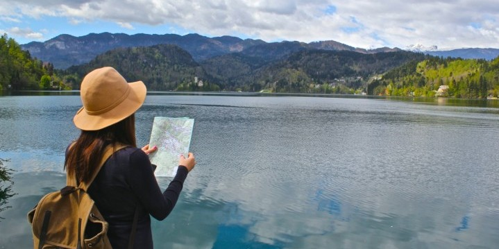 Travelling woman over lake