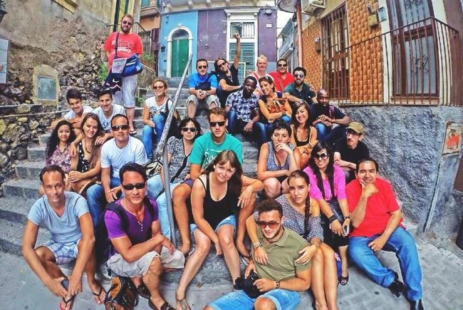 Travel the world volunteering like this group of happy volunteers