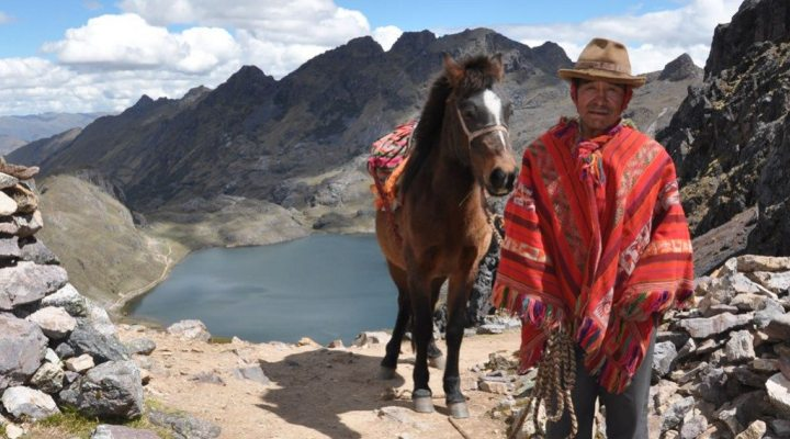 A man wearing a traditional Peruvian outfit with his horse; Another alternative way to Lares Trek