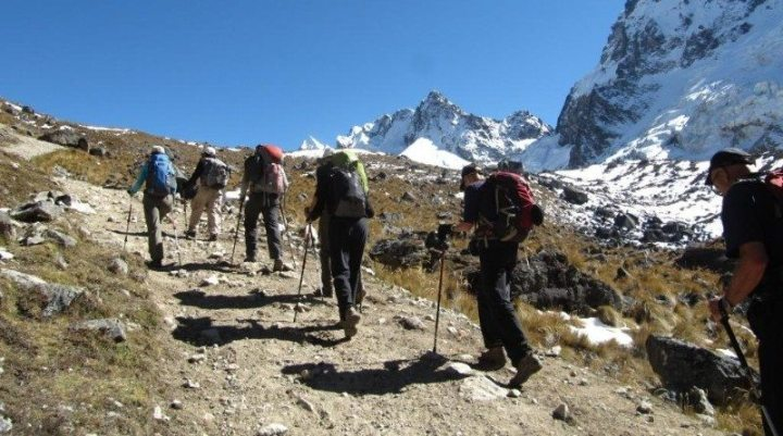 People with backpack trekking through the mountains, Salkantay trek