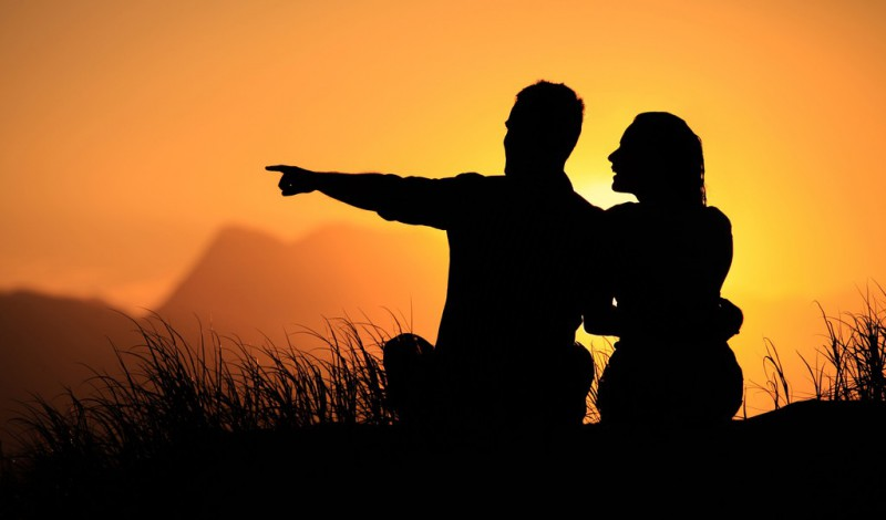 Silhouettes of a couple at sunset in africa