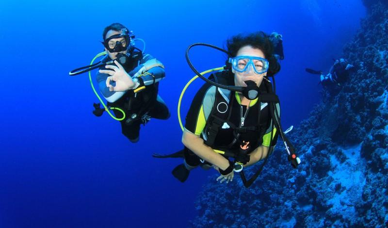 A couple scuba diving
