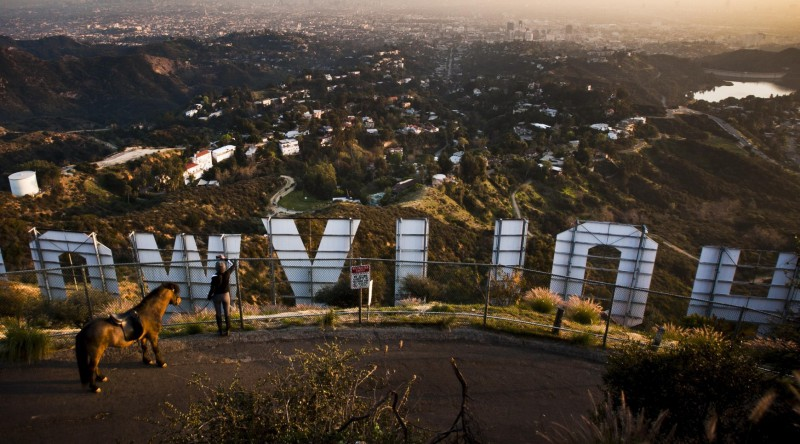 LOS ANGELES, CA - JANUARY 31, 2012: A women stops with her horse to photograph the famous Hollywood Sign over looking the Hollywood Hills on January 31, 2012, on Mount Lee, in Griffith Park, in Los Angeles, California. (Photo by Bret Hartman For The Washington Post via Getty Images)