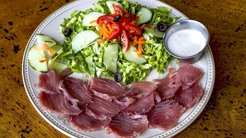 Yellowfin tuna sasami, fresh raw fish served with a green salad. Photo by Yvette Cardozo