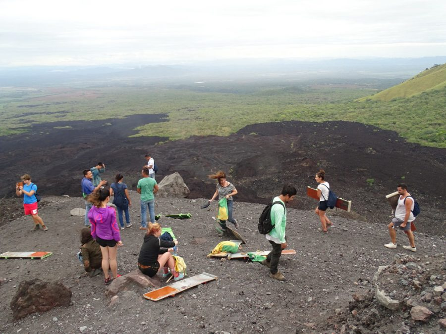 A group of tourists getting ready to slide down the side of Cerro Negro Valcano in Leon, Nicaragua
