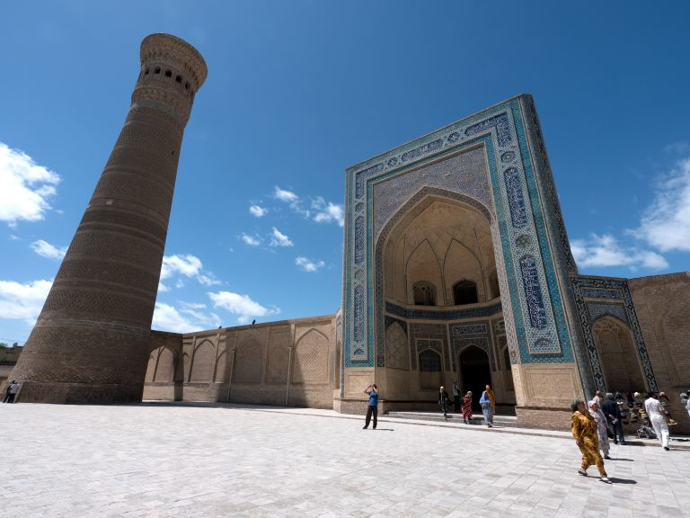 Blue tiled mosque and minaret in Bukhara, Uzbekistan