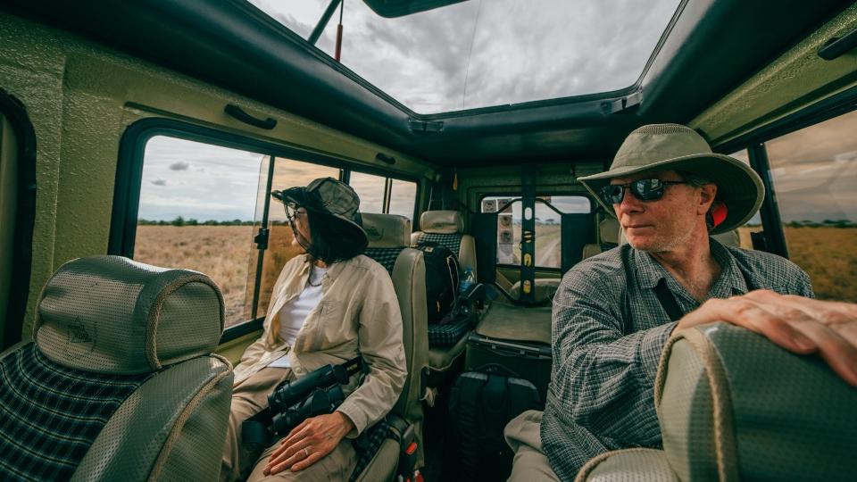 Couple in safari SUV
