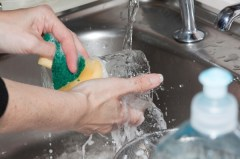 woman-washing-dishes-in-sink