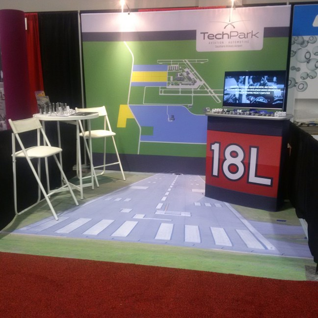 Dye-sublimated carpet for the SI Airport Tech Park featuring an image of an actual runway at the SI Airport.