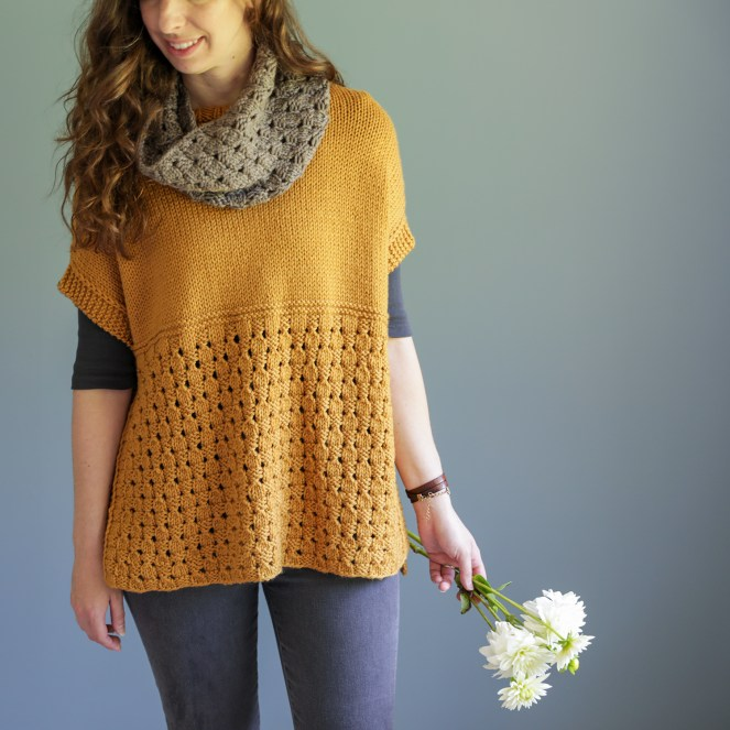 Photo of the Happy Harvest poncho and cowl set with model holding flowers in her hand