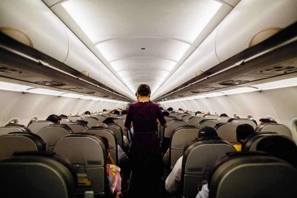 person standing inside airliner