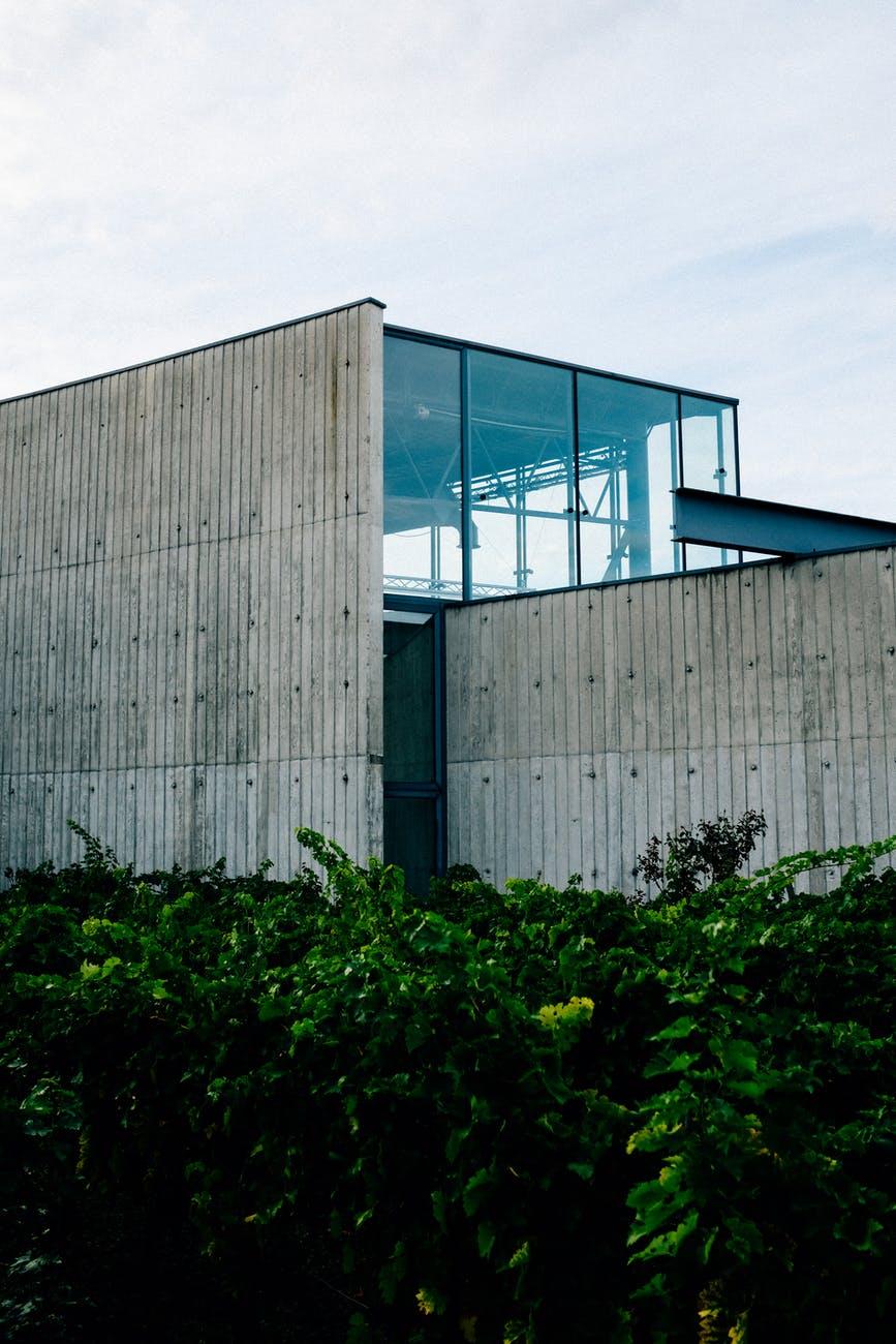 modern glass building with asbestos sheet siding