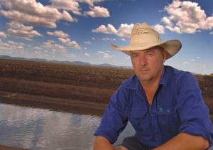 John Hamparsum sits in front of a flood plain