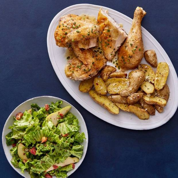 half chicken with roasted potatoes and salad