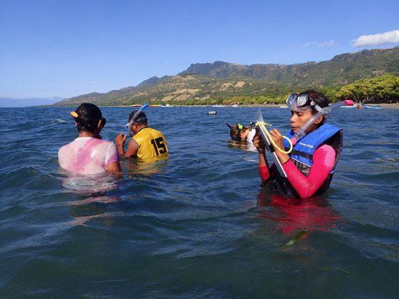 Monda and team conducting a survey | Photo: Christina Saylor
