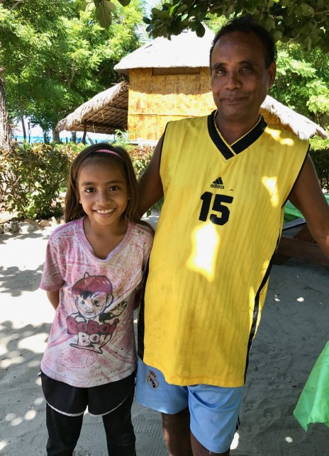 Homestay host Moses Alves with his daughter