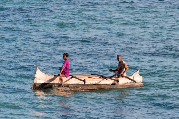A man and woman paddle their pirogue past Andavadoaka, southwest Madagascar | Photo: Ben Honey