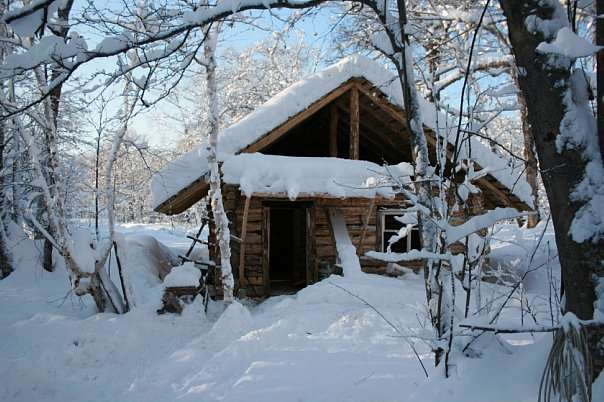 A traditional log hut built by a Kamchatka trapper