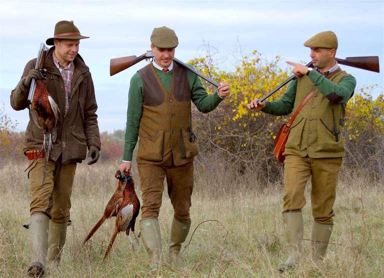 Pheasant hunters in traditional European attire