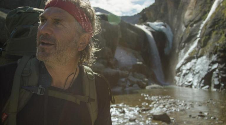 Jim Shockey near a waterfall