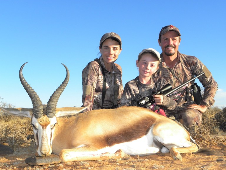 A family of hunters and a springbok