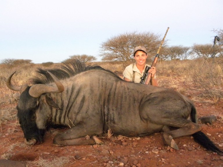 A female client with a wildebeest
