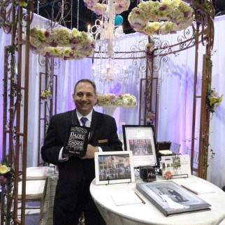 Michael Testagrossa accepts Dazzle Award at Bridal Spectacular