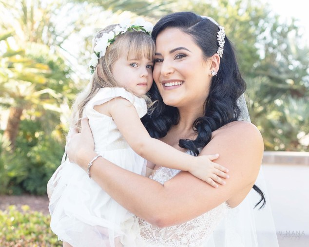 Bride and flower girl at Emerald at Queensridge