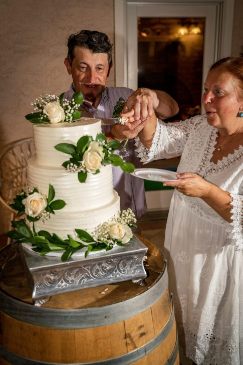 Mature Couple cut the cake at destination wedding in Las Vegas