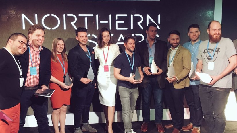 John awkwardly holding his award at Tech North's Northern Stars event.